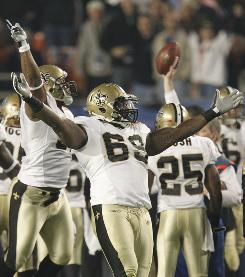 Saints defensive end Anthony Hargrove celebrates his team recovering the second-half-opening onside kick attempt. On the possession, the Saints scored to go up 13-10.