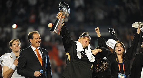 New Orleans Saints coach Sean Payton, raising the Vince Lombardi Trophy in triumph after his team won Super Bowl XLIV, gambled and won with his onside kick to start the second half, which was part of his &quot;get aggressive&quot; mantra.