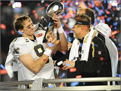 Saints quarterback Drew Brees and coach Sean Payton celebrate after New Orleans beat Indianapolis 31-17 in Super Bowl XLIV for the franchise's first NFL championship.