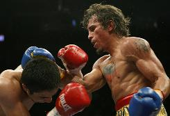 Venezuela's Edwin Valero, right, exchanges punches with Mexico's Antonio DeMarco. On Valero's chest is a tattoo of Venezuelan President Hugo Chavez and his nation's flag.