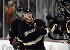 Saku Koivu, high-fiving his Ducks teammates on the bench, scored a goal as Anaheim won its 10th straight game at the Honda Center.