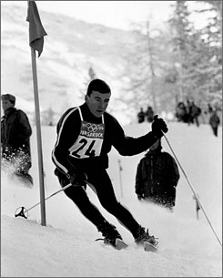 In this Feb. 7, 1964, file photo, American Jimmie Huega competes in the men's elimination slalom during the Winter Olympics at Lizum, Austria. Heuga, 66, who won a bronze medal in the event, died Monday.