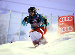 """World Cup moguls champion Hannah Kearney isn't concerend about the warm weather and lack of snow at Cypress Mountain. """"I've skied on rocks, I've skied on ice, I've skied in the rain. This is nothing,"""" the American said."""