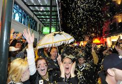 Saints fans on Bourbon Street in the French Quarter of New Orleans celebrate the 31-17 win against the Indianapolis Colts in Super Bowl XLIV.