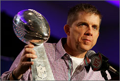 """Saints head coach Sean Payton holds the Lombardi Trophy on Monday during a news conference the day after New Orleans beat Indianapolis for the NFL championship. """"To be a coach and part of a great team with players like Drew Brees, I'm honored,"""" Payton said. """"I don't take that opportunity lightly at all. I feel very fortunate, very blessed, very humbled by it."""""""