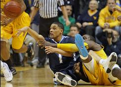 Villanova's Scottie Reynolds, left, and West Virginia's Darryl Bryant fight for a loose ball in the first half of the Wildcats' 82-75 win.