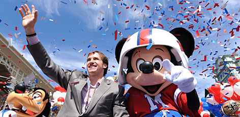 Drew Brees revels in the Super Bowl championship with Mickey Mouse during a parade at Walt Disney World after Brees was named MVP of Super Bowl XLIV.