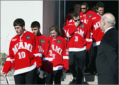 The Miami (Ohio) hockey team exits St. John The Evangelist Church after the funeral for ex-student manager Brendan Burke, son of Maple Leafs general manager Brian Burke.