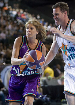 Nancy Lieberman drives to the basket past former NBA All-Star Dan Majerle during the 2009 NBA All-Star Celebrity Game in Phoenix.