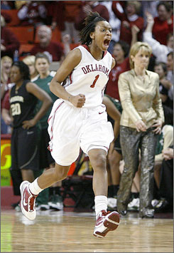 Oklahoma's Nyeshia Stevenson celebrates in front of the Baylor bench after hitting the game-winning jump shot in the Sooners' 62-60 overtime win.