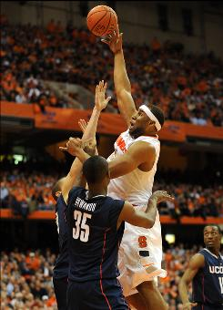 Syracuse forward Arinze Onuaku, right, shoots over Connecticut center Charles Okwandu during the second half at the Carrier Dome.
