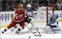 Sharks goalie Evgeni Nabokov, right, stopped 50 Red Wings shots as San Jose earned its first win over Detroit this season.