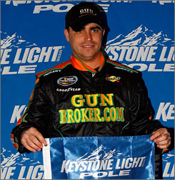 Jason White poses after capturing his first career Camping World Truck Series pole on Thursday night.