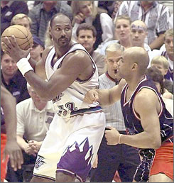 Karl Malone, left, finished his career as the NBA's No. 2 scorer with 36,928 points.