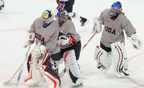 USA goaltenders Molly Schaus, Jessie Vetter and Brianne McLaughlin skate during a practice in Vancouver.