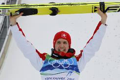 Switzerland's Simon Ammann celebrates Saturday after winning the gold medal in the ski jumping normal hill competition at the Vancouver 2010 Olympics in Whistler. Ammann is the first gold medalist of the Games.