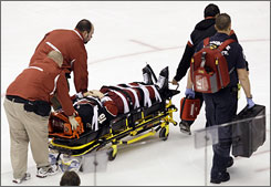 The Coyotes' Petr Prucha is taken off the ice on a stretcher after being knocked hard into the boards by the Stars' James Neal in the first period.
