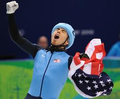 Apolo Anton Ohno of the U.S. celebrates after winning the silver medal Saturday night in the men's 1500 meter short track speed skating.
