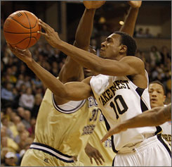 Wake Forest's Ishmael Smith goes to the hole against Georgia Tech during the first half. Smith made the game-clinching basket with just over a minute left.