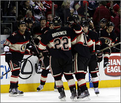 The Blackhawks' Troy Brouwer celebrates with his teammates after scoring the game-winning goal in a shootout.
