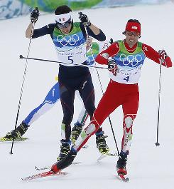 The USA's Johnny Spillane is about to be overtaken by Jason Lamy Chappuis of France in the final stretch of the Nordic combined competition on Sunday at Whistler Olympic Park. Spillane did hold on for silver, the USA's first medal ever in Nordic combined.