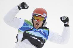 Seth Wescott of the USA celebrates after his gold-medal victory Monday in men's snowboard cross at Cypress Mountain.