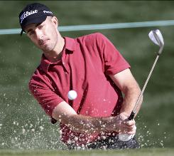 Geoff Ogilvy blasts from the sand during practice for the Accenture Match Play Championship Tuesday.