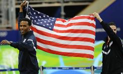 The USA's Shani Davis and Chad Hedrick celebrate winning the gold and bronze medals respectively in the men's 1000 meters Wednesday night.