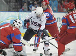USA forward Jenny Potter battles through traffic in the Russia zone. She scored her second consecutive hat trick in the game.