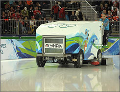 Problems with the Olympia ice resurfacing machines forced officials to bring in a Zamboni to help with the Olympic speedskating oval.