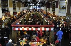 Wall-to-wall diners crowd the food court area of the Granville Island Public Market in Vancouver.