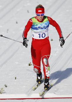 Kikkan Randall of the USA crosses the finish line during cross-country skiing's individual sprint classic Wednesday at the Winter Olympics in Whistler.