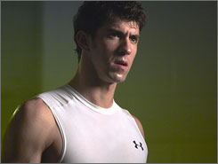 Michael Phelps is seen in an Under Armour shirt in a new ad.