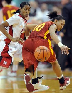 Nebraska's Yvonne Turner knocks the ball away from Iowa State's Denae Stuckey. Turner scored eight points as she passed her 1,000 career point mark.