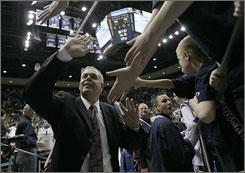 BYU coach Dave Rose celebrates with fans after the Cougars defeated Utah on Jan. 30. After battling pancreatic cancer in the offseason, Rose returned to the bench with a new mindset. &quot;If you get a chance,&quot; he says he told himself, &quot;you're going to do it right.&quot;