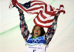 Shaun White celebrates winning the Olympic gold medal in the men's halfpipe finals on Wednesday.