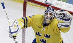 Swedish goalie Henrik Lundvist makes one of his 21 saves Wednesday in a 2-0 victory against Germany.
