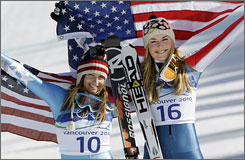 Lindsey Vonn, right, and Julia Mancuso ran first and second in the women's downhill race on Wednesday.