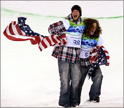 Scott Lago and Shaun White, right, celebrate two of the six medals earned by the USA on Wednesday. Lago took bronze and White took gold in the men's snowboard halfpipe.