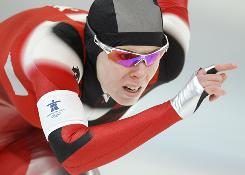 Canada's Christine Nesbitt skates during her gold-medal women's 1,000 meter speed skating race Thursday at Richmond Olympic Oval in Vancouver.