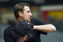 Arizona Diamondbacks pitcher Brandon Webb throws during a pre-spring training baseball warmup at Chase Field in Phoenix on Friday. Webb had shoulder surgery in 2009.