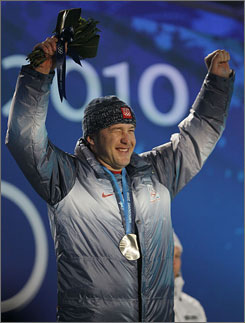 Bode Miller winks to his family in the crowd after receiving his silver medal in Friday's men's super-G.