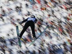 Peter Frenette of the USA takes his jump Friday during round one of the Large Hill Individual ski jump event at the Whistler Olympic Park. Frenette qualified 30th and would get a second jump.