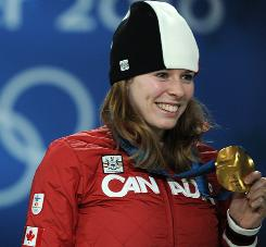 Canada's Christine Nesbitt celebrates her gold medal from the women's 1000m speedskating race. Teaqm Canada coach Marcel Lacroix hopes Nesbitt's win will encourage the rest of the team to excel.