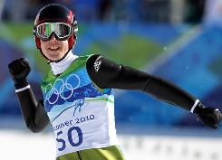 Simon Ammann reacts after competing in the mens ski jumping individual final. He won the gold medal for Switzerland.
