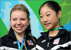Both Rachael Flatt, left, and Mirai Nagasu went home after the Opening Ceremony to practice, but have returned to Vancouver with their competition set to begin Tuesday,