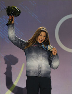 American skier Julia Mancuso won silver medals in the downhill and super combined, two of the seven medals won by the U.S. Alpine team so far in Vancouver.