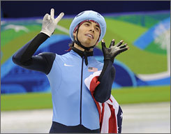 The USA's Apolo Anton Ohno comes through with a bronze medal in the men's short-track 1,000 meters Saturday at the Pacific Coliseum. It was Ohno's seventh career medal in the Winter Olympics.