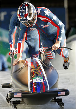 Mike Kohn, front, will be the driver on the U.S. four-man bobsled team.