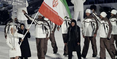 Flag-bearer Marjan Kalhor, second from left, carries the flag in for Iran during the opening ceremonies for the Vancouver Olympics on Feb. 12.
